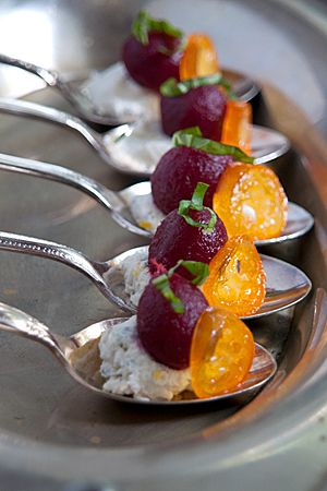 SPOONS: Pickled Baby Beets with Herbed Goat Cheese and Kumquats.