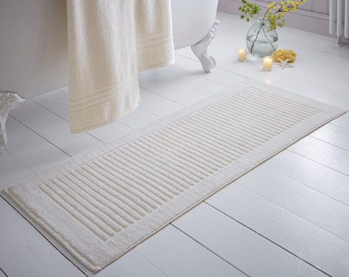 Extra Long Bathmat £10.00 Extra long bath mat in thick towelling cotton, co-ordinates perfectly with the Quick Dry Towel Bales. 800gsm. 100% cotton. Machine washable. L120 x W50cm. Available in Cream, Blue or Latte.