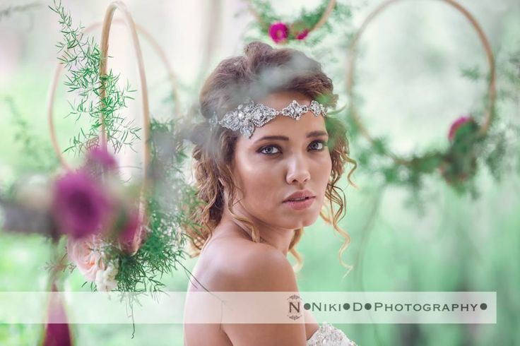 Hanging hoops delicately decorated with flowers are the perfect backdrop for our bride. Photography https://au.pinterest.com/NikiDPhoto/