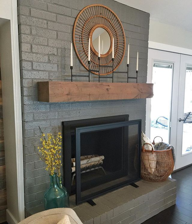 Painted fireplace update.  Loving the wood beam mantel against the gray and black.