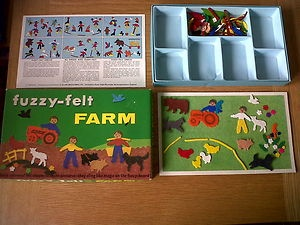 i had the fuzzy felt farm! with the orange tractor just like my daddy's.