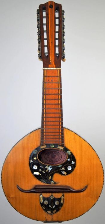 My Jeremias Padilla 14 string Bandola de Colombia at Ukulele Corner  I'm posting this unstrung partly because where do you get Bandola de Colombia strings? But mainly in honor of Colombia's independence day  --- https://www.pinterest.com/lardyfatboy/