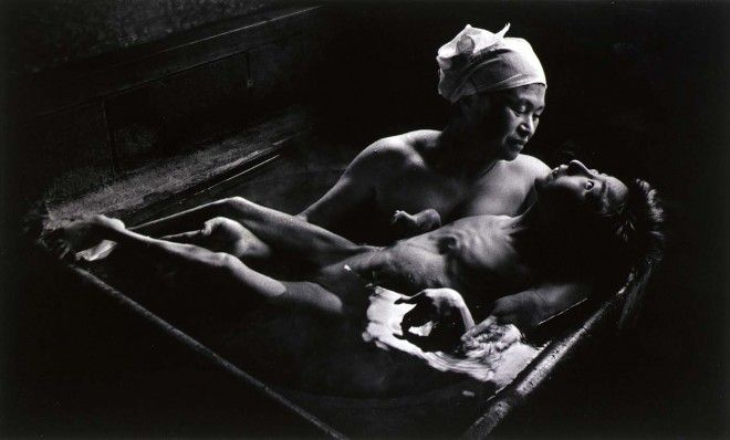 Tomoko in Her Bath; Mother and her daughter, a sufferer of Minamata Disease, Japan. Copyright: Magnum Photos, photo by W. Eugene Smith