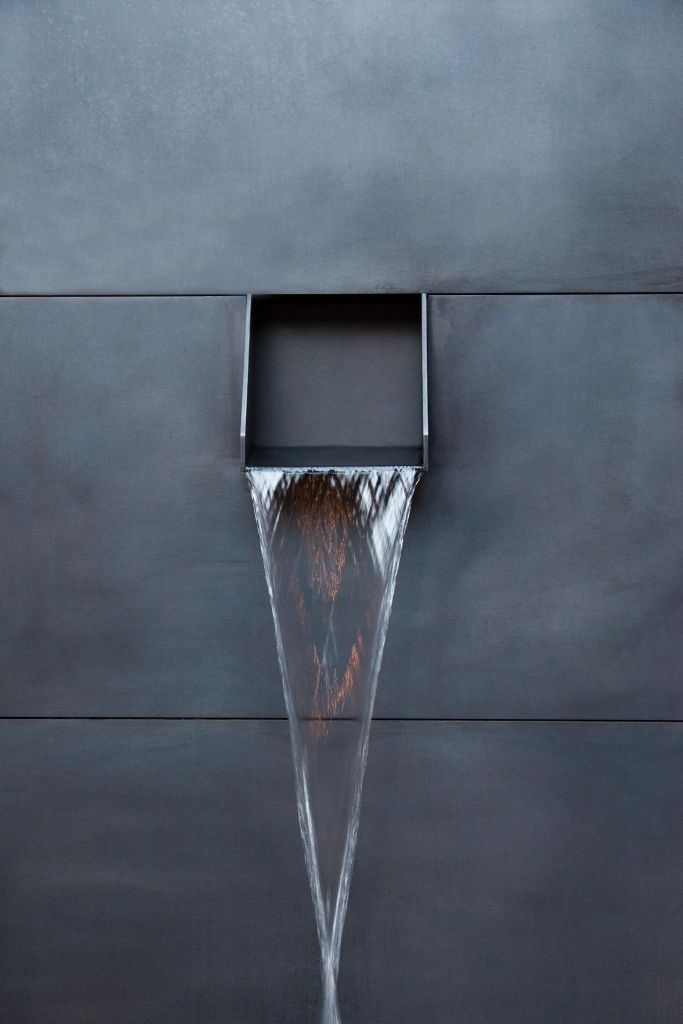 Fountains & Ponds | Contemporary metal spout from concrete facade