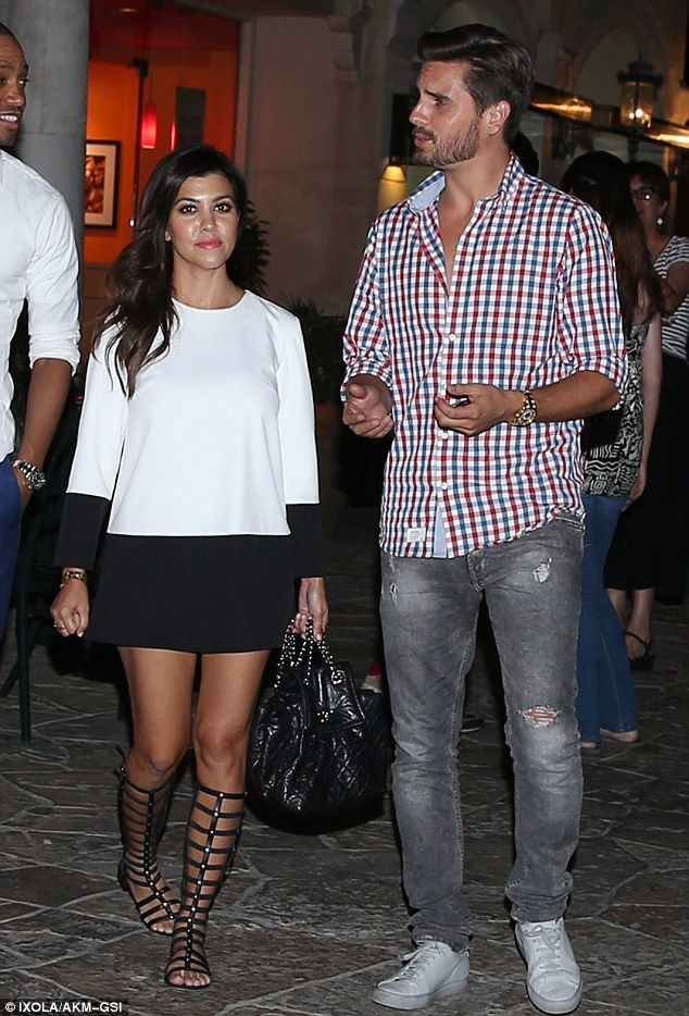 Monochrome Monday: Kourtney Kardarshian captured attention in gladiator sandals and a black and white dress for dinner out with Scott Disick and her mother Kris Jenner in Calabasas
