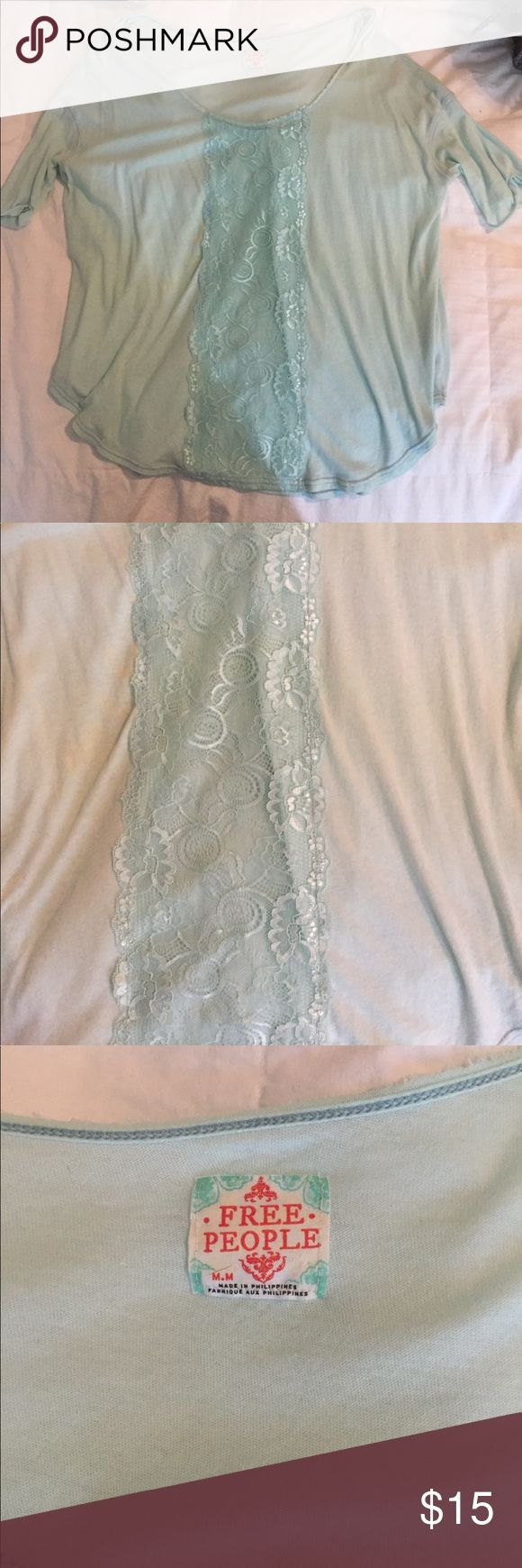 Free people Mint green/turquoise tee Flowy & comfortable. Can be worn off shoulder, tie it on side. Cute lace detailing down front. Like brand new Tops Tees - Short Sleeve
