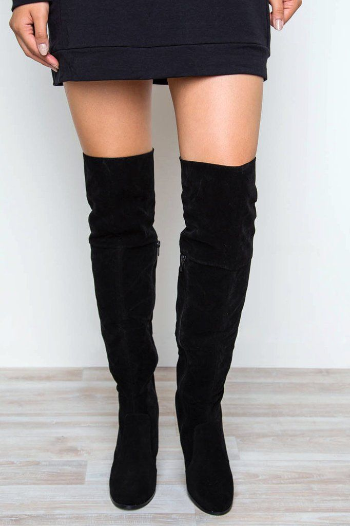 All eyes will be locked on you when you walk by in the Locklyn Suede Knee High Boots in black! Featuring a faux suede in an over-the-knee styling. Partial side-zip closure and lace-up corset detail at