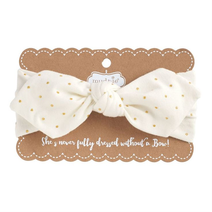"""Printed cotton spandex bow headbands arrive on display card with """"She's never fully dressed without a Bow!"""" sentiment. This headband is a perfect addition to any Mud Pie outfit. Great for Spring and Summer months and sweet for any family photo, holiday and trip to Grandma's house!"""