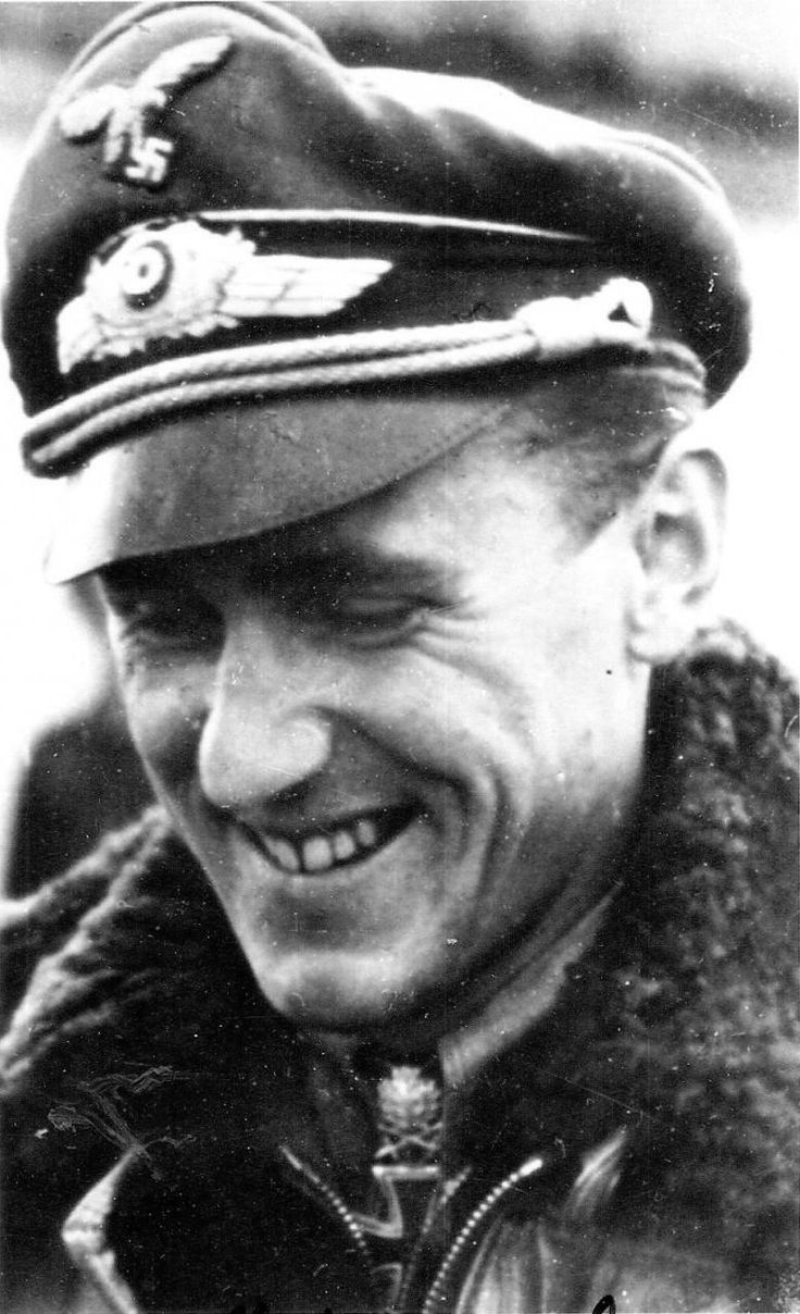 German ace fighter pilot Major Günther Rall (10.03.1918 - 04.10.2009). He was 3rd among German aces of World War II with 275 confirmed aerial victories (272 of them on the Eastern Front), scored during 621 sorties. Sam Rall was shot down eight times. In the photo he is wearing the Knights Cross with Oak Leaves and Swords, which he was awarded on 09/Dec/1943, after his 200th aerial victory.