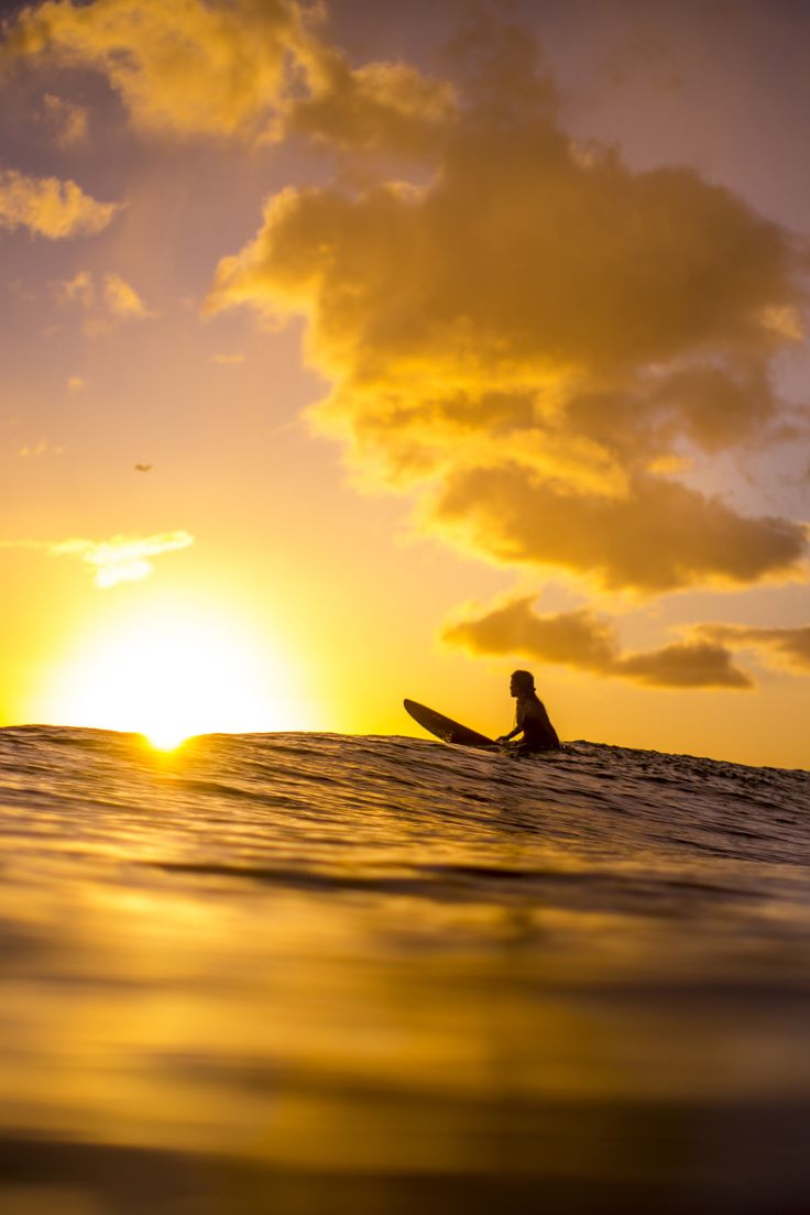 Always end the day as you started it in Hawaii: on the beach watching the surfers and the sunset.   From Zak Noyle's #OneMoreDay adventure in Hawaii.