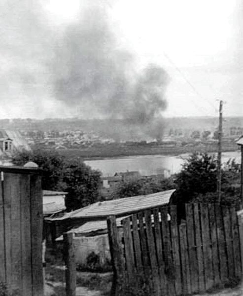 Kovno ghetto in flames.Credit: George Kadish, photographer; Beth Hatefutsoth, Israel.