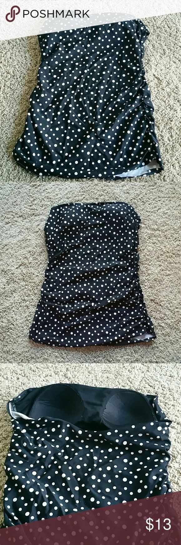 Slimming  tankini The shape and the ruffles of this tankini are extremely slimming. The dots are super cute and easy to match to swim bottoms!! There are tiny little snags on it and it seems noticeable in the light i took the pictures in, but they are very subtle. Swim One Pieces