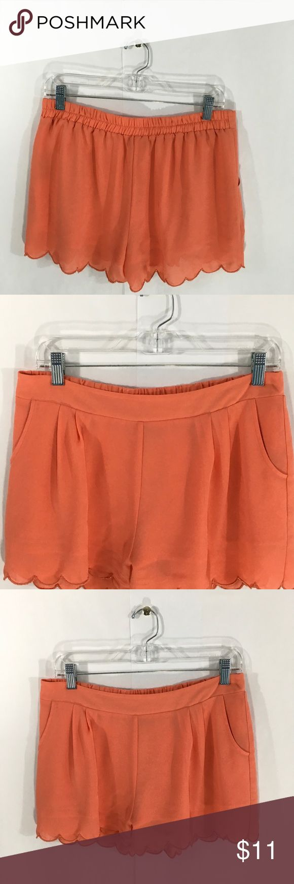Mine peach shorts Mine peach shorts with wave trim. Shorts have 2 hand pockets are a elastic waist band only in the back.  Measurements are approximate and taken laying flat  Length 13' Waist 18' mine Shorts