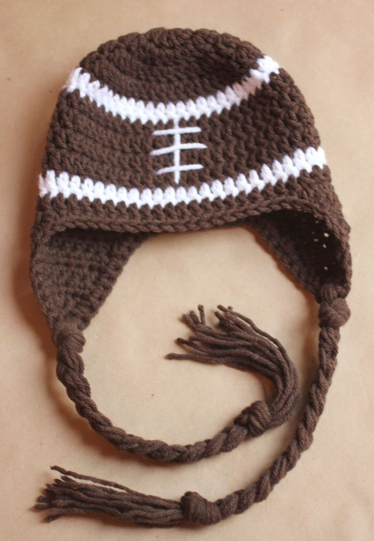 Hmmmm... Could I possibly pull this off after years of uncomplicated crocheted blankets? From Repeat Crafter Me: Crochet Football Earflap Hat FREE Pattern