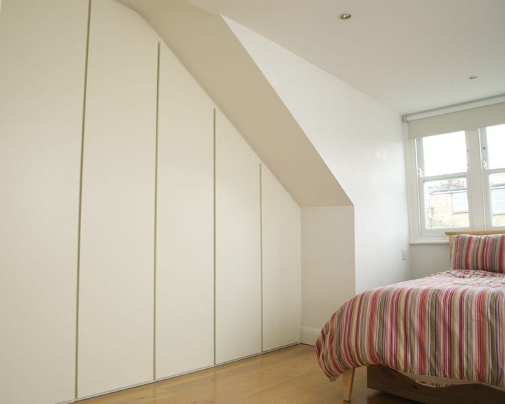 contemporary fitted wardrobes for a loft bedroom with his and hers
