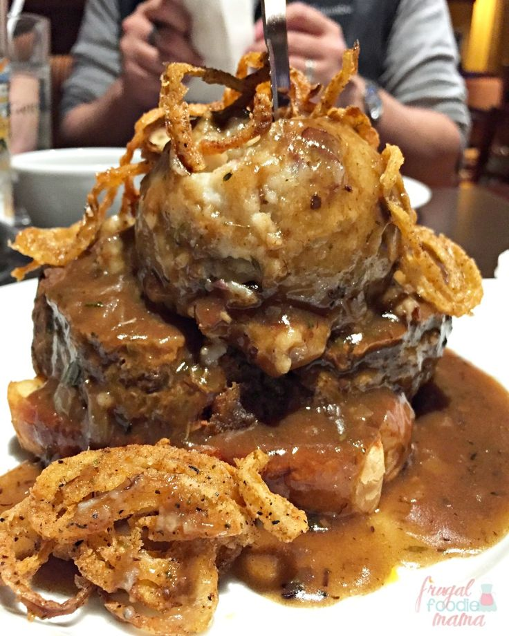 The Mile High Meatloaf from Appalachian Brewing Company is a thick slice of tender Angus beef meatloaf that is served over Texas Toast and then topped with a beer gravy, garlic mashed potatoes, and crispy fried onion straws