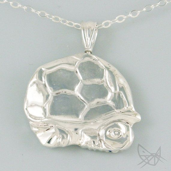 Skull-Turtle: Made of 100% recycled sterling silver this reversible pendant measures about 1 inch wide and features a swivel action so that it can be switched without taking off the necklace.    themercurius.com   #TurnaboutJewelry