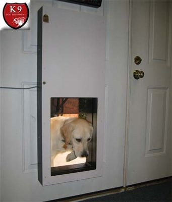 The Solo Automatic dog door is activated by a magnet. A polycarbonate door is lifted by a pulley mechanism. After a pre-selected time, the pulley will release and the door panel will come down gently. http://www.k9dogequipment.com/Solo-Automatic-Dog-Doors-p/solo-automatic.htm