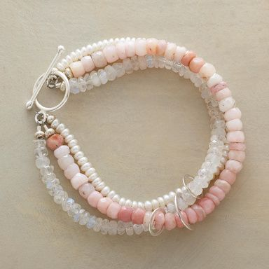 """BLUSHING BRACELET -- Pink opals, moonstones and cultured pearls ring the wrist, linked into a twist with sterling silver hoops and toggle clasp. Exclusive. Handcrafted in USA. 7-1/2""""L."""