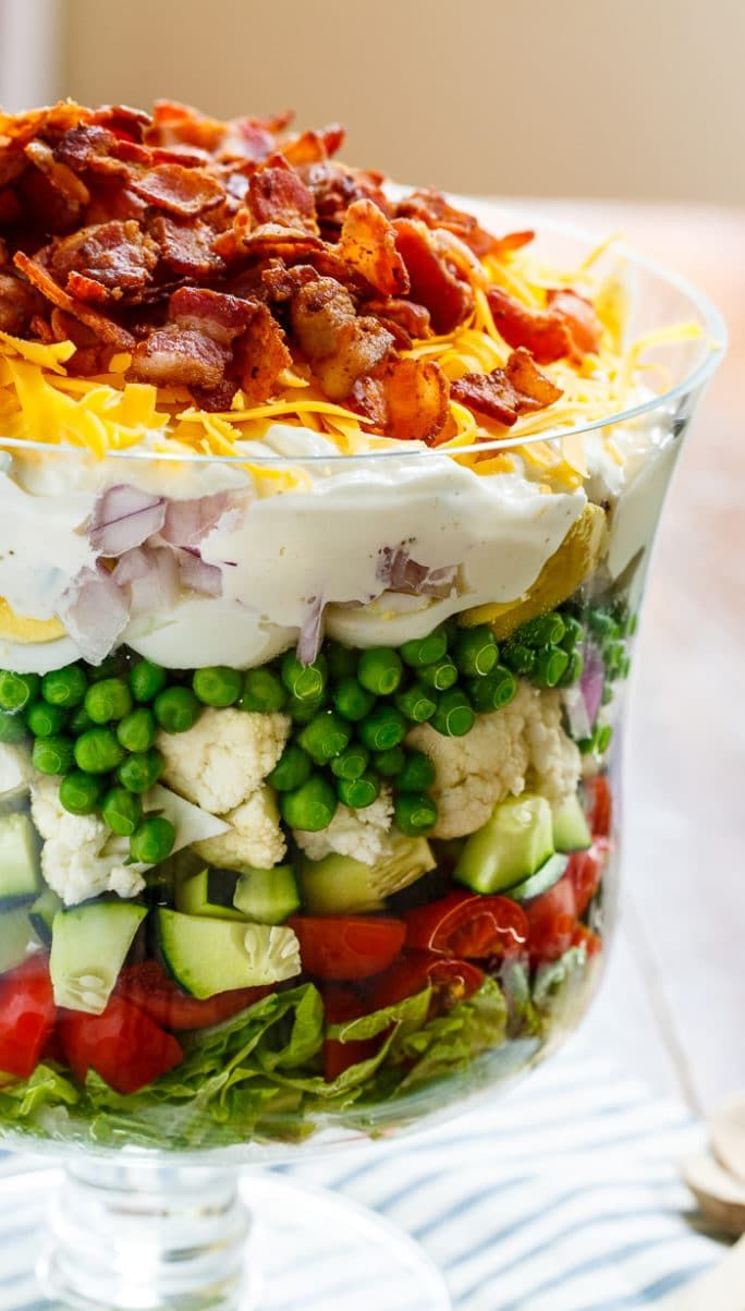Seven Layer Salad is the perfect salad for potlucks and picnics. Easy to make ahead of time and feeds a crowd.