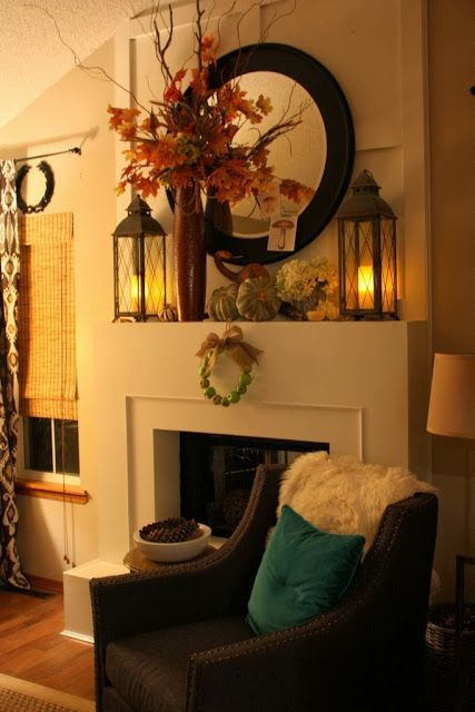 Fall, Autumn, Harvest Mantle with a tall vase in front of a round mirror.