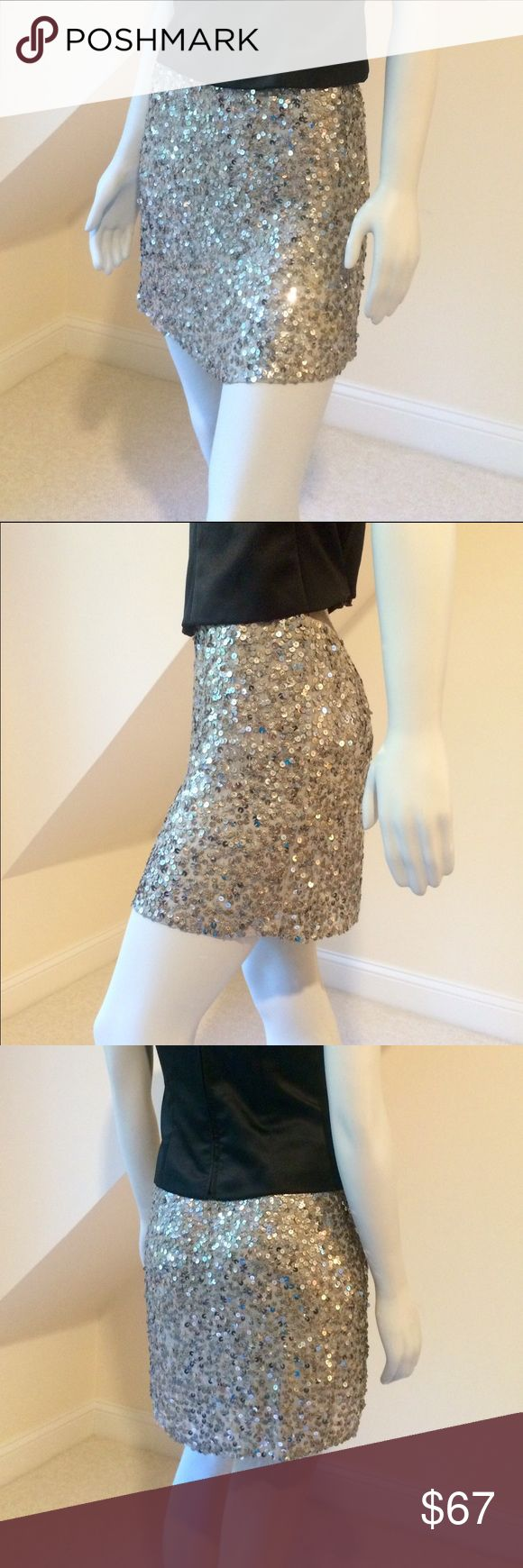 Alice + Olivia Sequin Skirt Alice + Olivia Sequin Skirt....thick metal sequins adorn sheer mini...elastic waist...silver, platinum and gunmetal reflect light beautifully...fully lined...100% silk. ***a few sequins may be missing, not noticeable when worn and reflected in price*** Retail $435 Alice + Olivia Skirts Mini