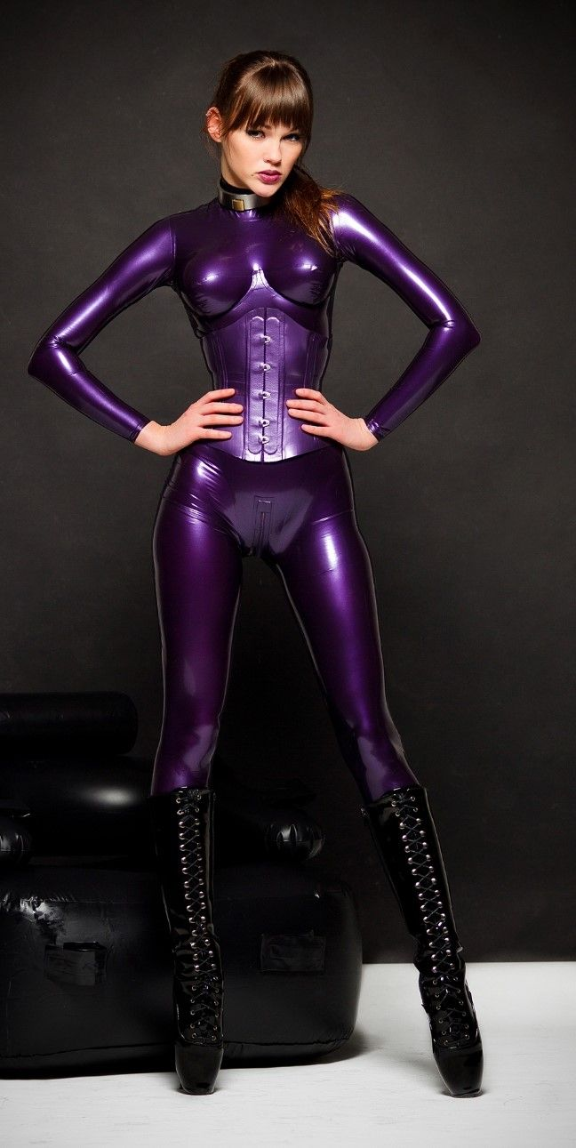 Alexandra potter in purple latex corsetted bodysuit and knee high black ballet boots
