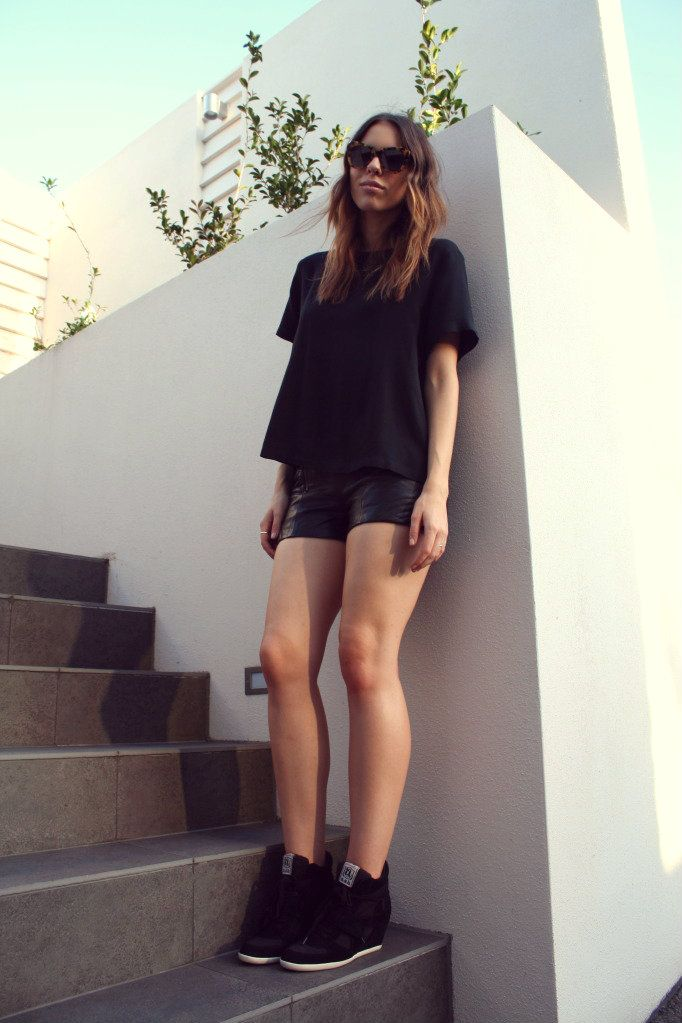 Vintage top, Guess shorts, Ash 'Bowie' Wedge Sneakers, Karen Walker Number One Sunglasses.