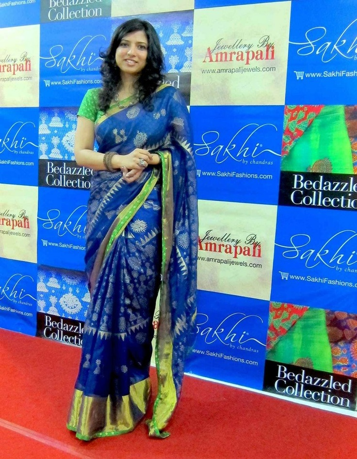 Sakhi's Neeta Rajendran adorning a signature saree from the Bedazzled Collection- Silk Kota with bold Tissue border in brilliant Deep Blue contrasted by Brilliant Green. The highlight being the Jewellery inspired gold khadi block print. For more details. contact@SakhiFashions.com / +91 9900033636