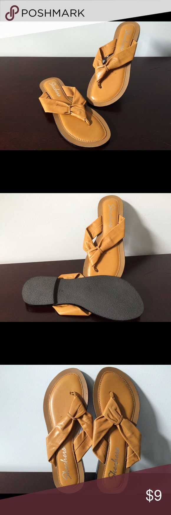 Skechers Flat Sandal Slipper Up for sale are these simple sandals by Skechers. Slipper style, slide on. Decorative knot design. Flat heel, cushioned insole. Mustard color. Pairs well with a loose skirt & summery top. Skechers Shoes Flats & Loafers