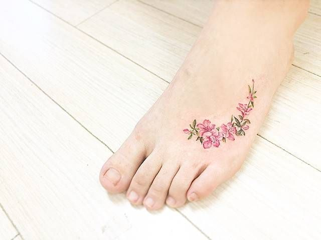 Watercolor+style+apple+blossom+tattoo+on+the+left+foot.+Tattoo+artist:+Banul