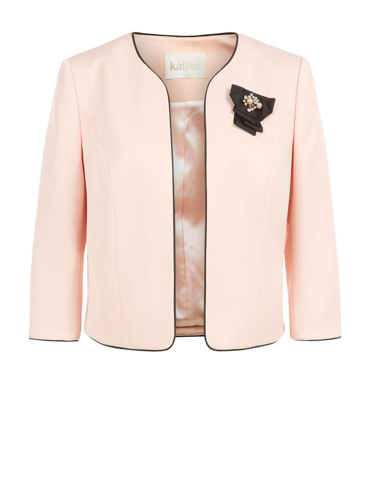 In a gorgeous rosewater shade, this jacket features a black grosgrain corsage with tonal central detailing to add a lovely feminine finish. It has an edge-to-edge style, with piping detailing around the neckline.