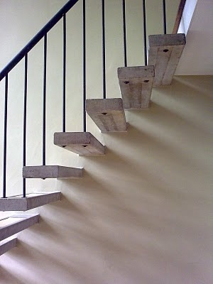 floating stairs with vertical rods and rail