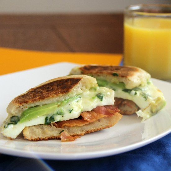 Egg white breakfast sandwich with bacon, avocado, spinach and Pepper ...