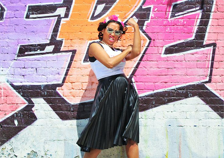 """I AM WOMAN"" Photography: Dwayne Daniels II Stylist: Courtney McCullough Model: Courtney McCullough Wardrobe: Get this look for $50.00  Skirt by Alice + Olivia (found at consignment) TRY tee by TJ Maxx Sunglasses by HM Floral Headband by Forever 21 Heels by Goodwill Thrift"