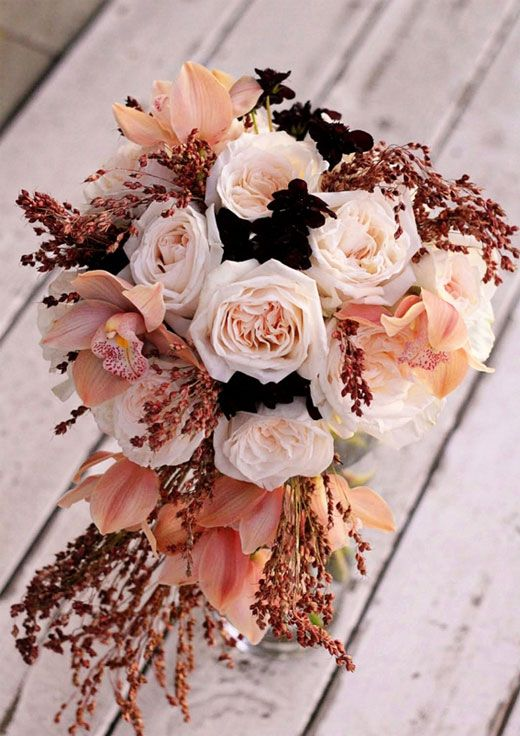 For all those chocolate-loving girls! What a strikingly unsusual combination of chocolate cosmos, cymbidium orchids and broomcorn. It also reminds me of coffee.