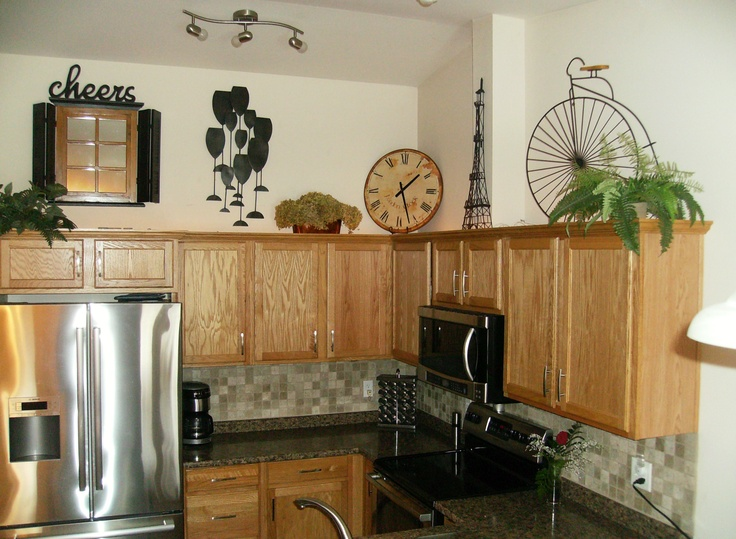 the kitchen cabinets with limited greenery for the