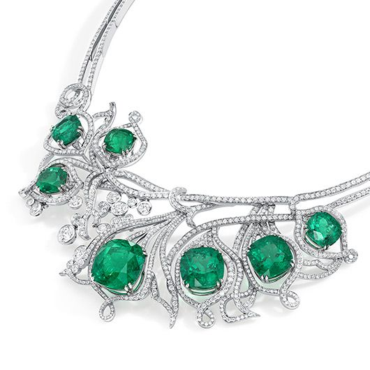 An ethereal green fire burns within richly coloured emeralds, their luminosity symbolising a beam of light as it strikes through forest foliage. Petal shaped flames dance amongst swirling tendrils creating a natural harmony between the elements: earth and fire. Featuring the finest untreated Columbian Emeralds from the Muzo mines.