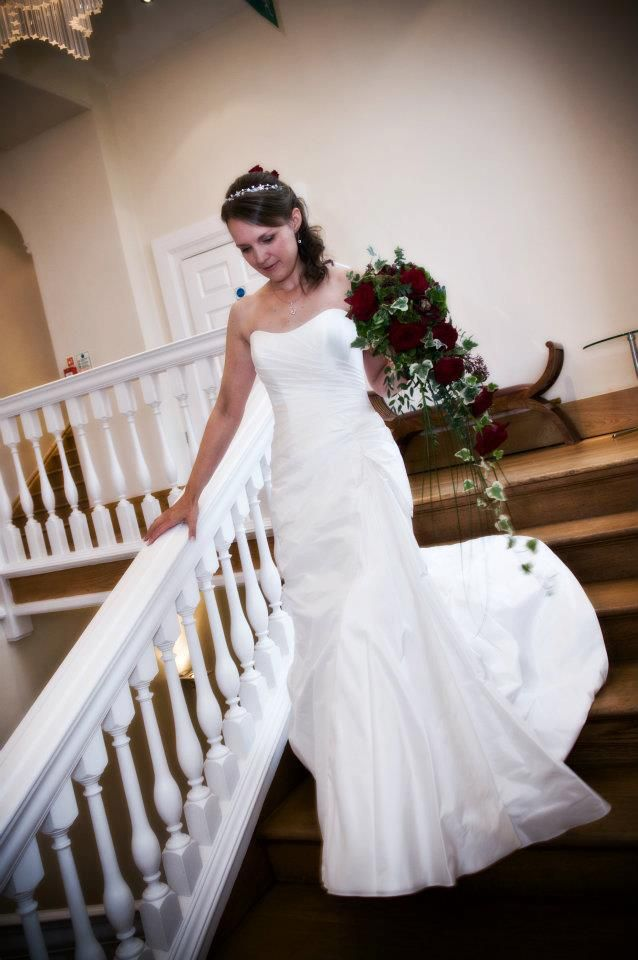 Bride walking from Bridal Suite at Notley Abbey, flowers by www.wildorchidweddingflowers.co.uk