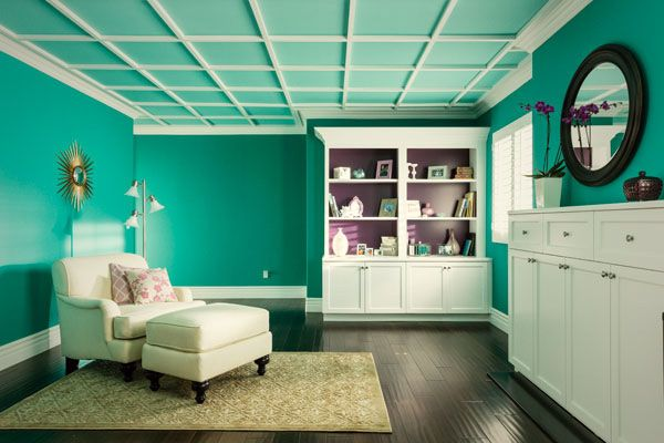 A splash of color and pocket ceilings make this space The