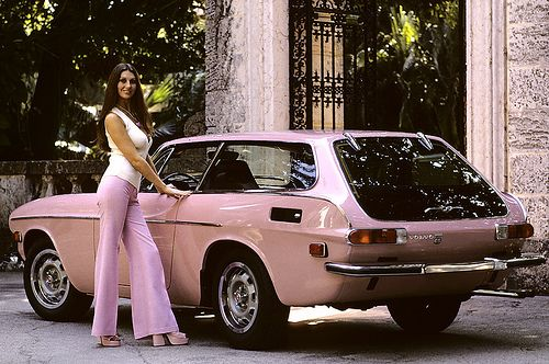 1973 Volvo p1800.  My then boyfriend had one in metallic light blue.  I loved driving that car!