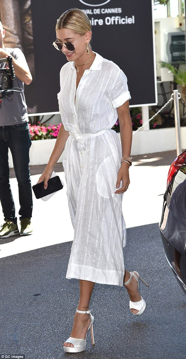 White hot: Hailey Baldwin, 20, paired a white linen shirtdress with a pair of sky-high satin stilettos while in Cannes recently