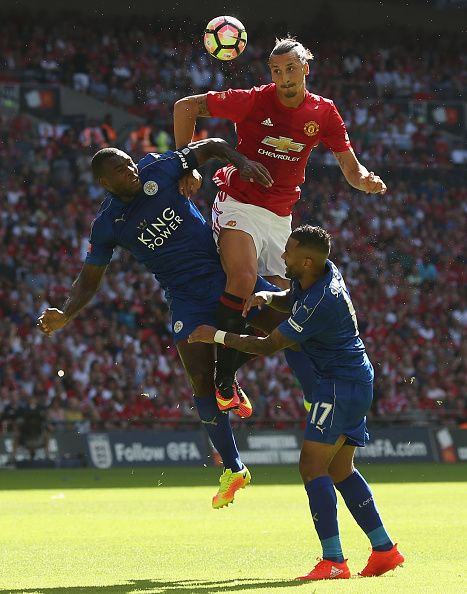 Zlatan Ibrahimovic of Manchester United in action with Wes Morgan and Danny…