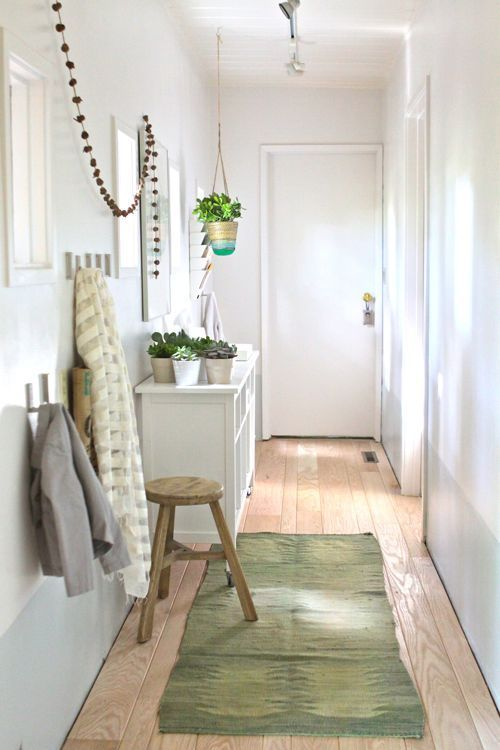 Long hallway turned functional mud room.