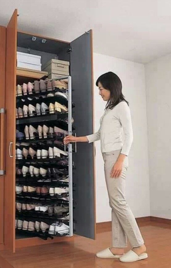 Interesting larder-style pull-out cabinet makes shoes