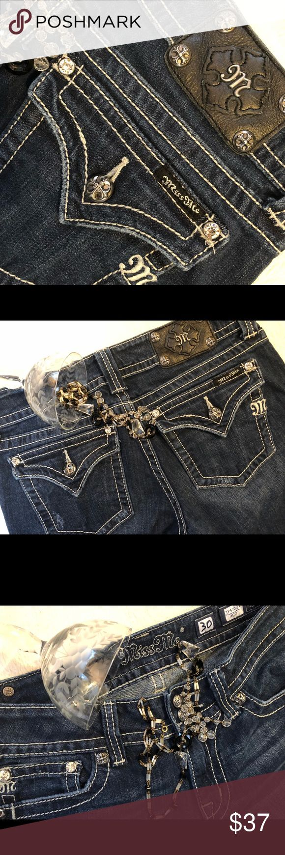 Miss Me jeans W 30 I 32 distressed Miss Me Jeans W30 R8 I32 . Good used condition. Gems and cute cross buttons ! Please check photos to make sure you are happy with distressing. A couple of loose stitches on one hem that could easily be repaired. Miss Me Jeans Boot Cut