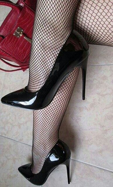 Black patent heels and fishnet stockings. Classic and sexy.