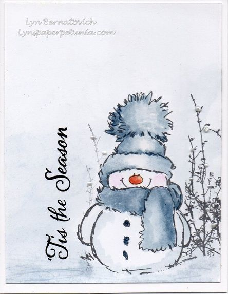 "By Lyn Bernatovich. Stamp snowman (""Snowy"" by Penny Black) in black StazOn or archival ink. Watercolor. Mask. Stamp brush (""Berry Bevy"" by Penny Black); sponge snow hill. Lift mask. Stamp sentiment. Add pearls, Pearl Pen, Liquid Pearls, etc."