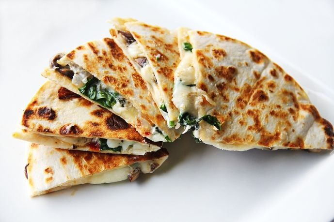 Spinach, Sundried Tomato, Mushroom & Goat Cheese Quesadilla - Just needs to be drizzled or dipped in hot sauce.
