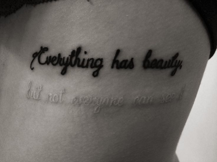 """Everything has beauty, but not everyone can see it."" Quote tattoo. White ink. Ribs."